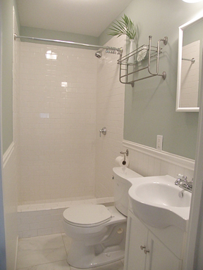 awesome both bathrooms have a seat hight toilet white subway tile  wainscoting and a towelrack with subway tile wainscoting