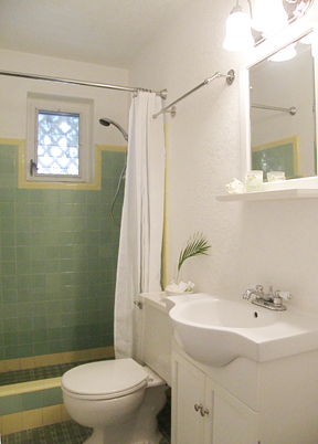 bathroom is small but with linen closet and original charm
